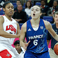 11 August 2012:  France Clemence Beikes drives past Maya Moore during 86-50 Team USA victory over Team France, during the Women's Gold Medal Game, at the North Greenwich Arena, in London, Great Britain.