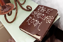© Licensed to London News Pictures. 26/03/2012. London, UK. The Cavendish hotel on Jermyn Street has created a 'chocolate room'  in which around 100kg of chocolate has been used to create various hotel items out of chocolate, including a 'Do Not Disturb' sign, a pair of slippers, two toothbrushes and toothpaste, a headboard, a teapot and cup set and a giant chocolate easter egg and rabbit.  The chocolate creations were made by students and lecturers of Westminster Kingsway School of Hospitality. One lucky person will be staying in room 1215 tonight (26/03) after the results of a TimeOut magazine competition decides the winner later today.  Photo credit : James Gourley/LNP