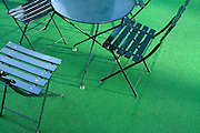 garden chairs on fake green grass carpet