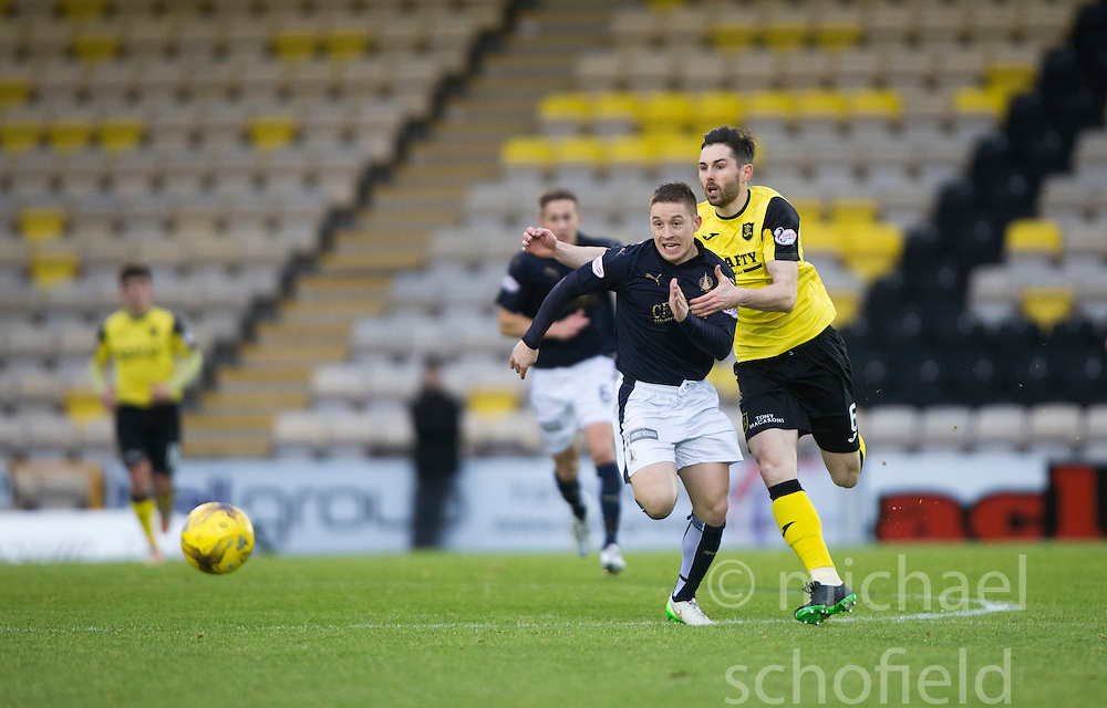 Falkirk's John Baird and Livingston Ben Gordon. <br /> Half time : Livingston 0 v 1 Falkirk, Scottish Championship game at The Tony Macaroni Arena at 23/1/2016.