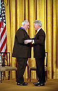 President Bill Clinton is surprised by former German Chancellor Helmut Kohl with a hug after presenting him with the Medal of Freedom at the White House April 20, 1999. Kohl received the medal for his many years of good relations with the U.S and is the first foreigner to receive the honor since 1991.