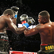 """Yuniel Dorticos (right) beats Edison Miranda during the """"Judgement Day"""" boxing event at American Airlines Arena on Thursday, July 10, 2014 in Miami, Florida.  (AP Photo/Alex Menendez)"""