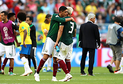 Mexico's Edson Alvarez embraces team-mate Carlos Salcedo after they are knocked out of the tournament