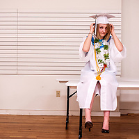 051613       Cable Hoover<br /> <br /> Gallup Catholic High School graduate Rachel Jones adjust her cap before the start of her graduation ceremony at El Morro Theater Thursday in Gallup.