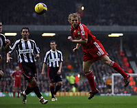Photo: Paul Thomas.<br /> Liverpool v Sheffield United. The Barclays Premiership. 24/02/2007.<br /> <br /> Dirk Kuyt of Liverpool headers a pass to Steven Gerrard, which leads to him getting fouled in the box by Nick Montgomery.