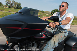 Moonshiner (reality tv show star) Josh Owens riding in the Annual Legends Ride at 75th Annual Sturgis Black Hills Motorcycle Rally.  SD, USA.  August 3, 2015.  Photography ©2015 Michael Lichter.