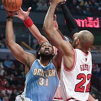08 November 2010: Denver Nuggets' center #31 Nene Hilario goes to the basket against Chicago Bulls' forward #22 Taj Gibson during the Chicago Bulls 94-92 victory over the Denver Nuggets at the United Center, in Chicago, Illinois, USA.
