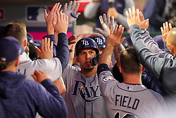 May 18, 2018 - Anaheim, CA, U.S. - ANAHEIM, CA - MAY 18: Wilson Ramos (40) of the Rays is congratulated by teammates after hitting a home run during the major league baseball game between the Tampa Bay Rays and the Los Angeles Angels on May 18, 2018 at Angel Stadium of Anaheim in Anaheim, California. (Photo by Cliff Welch/Icon Sportswire) (Credit Image: © Cliff Welch/Icon SMI via ZUMA Press)