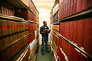 Joshua Odumuso, 23 years old Law student in the Franciscan library of the University of Buckingham. The University of Buckingham is unique. It is the only independent university in the UK with a Royal Charter, and probably the smallest with just around 1000 students. Honours degrees are achieved in two intensive years of study. The University campus is well known for being one of the most attractive locations in the region. The Great Ouse river, home to much wildlife, winds through the heart of our campus. Much of our teaching takes place in our restored buildings. Each student mixes with 89 other different nationalities and so being at Buckingham is just like being in a mini global village.