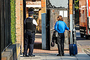 A resident walks by as Police continue their investigation on Tuesday, Sept 15, 2020 - after man has died of stab wounds in Islington, North London on Monday. Police have launched an investigation after they attended North Road N7 around 8 pm and found a male, thought to be a teen, with stab wounds. (VXP Photo/ Vudi Xhymshiti)