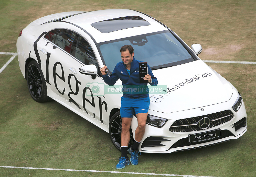 STUTTGART, June 17, 2018  Roger Federer of Switzerland poses with the trophy and his new Mercedes-Benz CLS 450 4MATIC Coupe after the singles final against Milos Raonic of Canada at ATP Mercedes Cup tennis tournament in Stuttgart, Germany on June 17, 2018. Roger Federer won 2-0 to claim the title. (Credit Image: © Philippe Ruiz/Xinhua via ZUMA Wire)