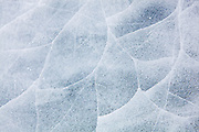 Detail of the frozen ice surface of Mills Lake in Rocky Mountain National Park, Colorado.
