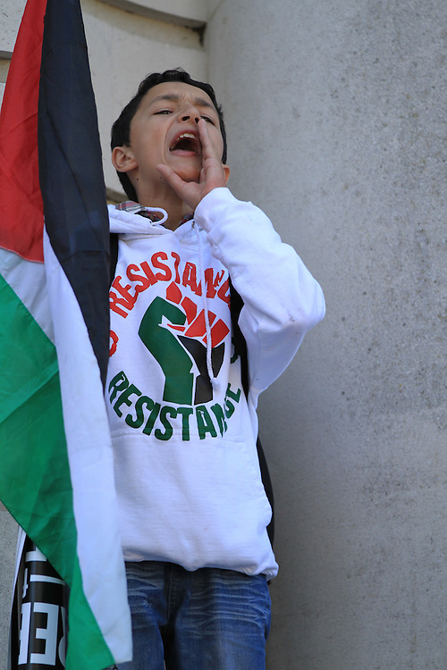 A young boy shouts 'Freedom for Palestine' at a protest in Cardiff ahead of Israel's UEFA Championships match with Wales. Protesters highlighted Israel's occupation of Palestine.