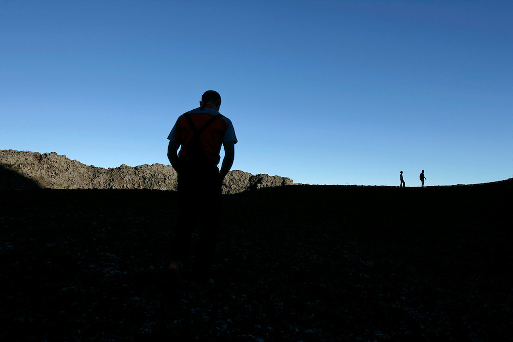 Hikers walking inside the dormant volcano's crater to sea the view from the border.