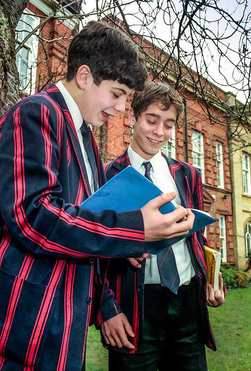 pupils outside private schools discussing lesson,