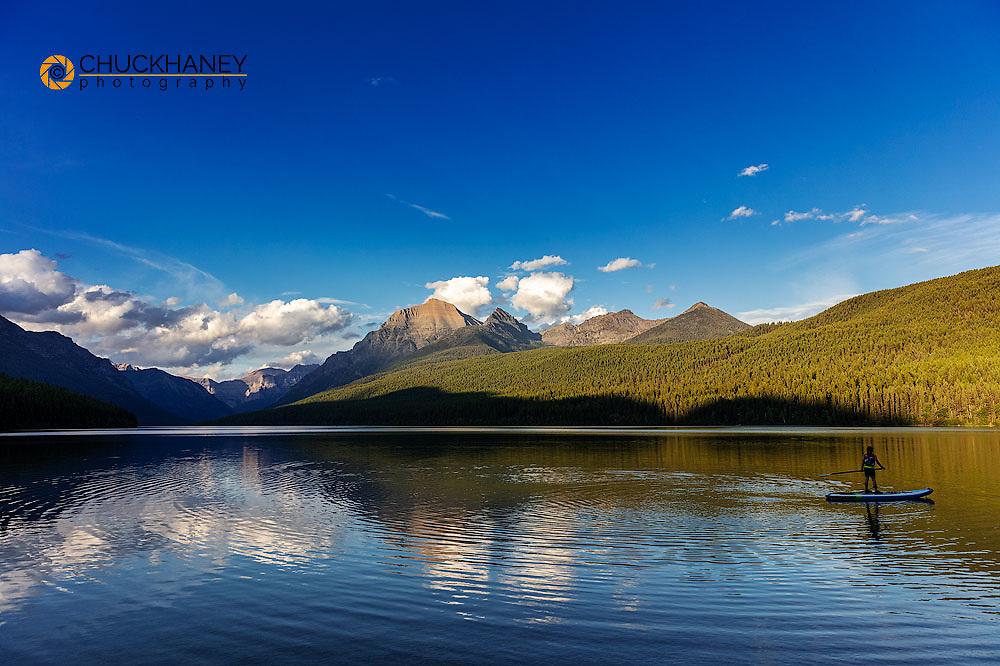 Standup paddleboarding on Bowman Lake in Glacier National Park, Montana, USA