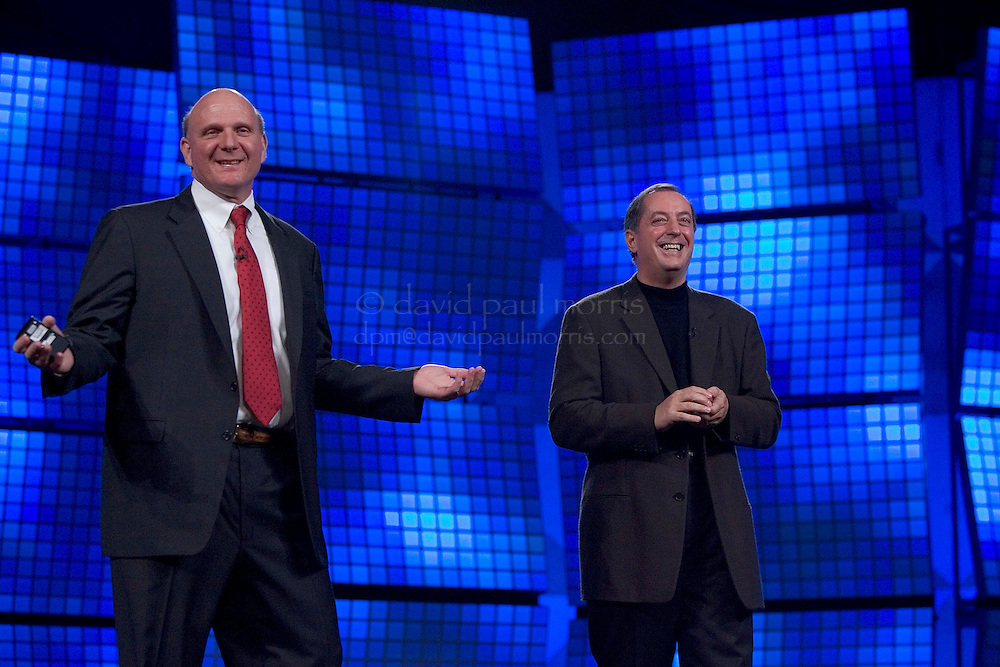 SAN FRANCISCO - NOVEMBER 7:  Microsoft CEO Steve Ballmer (L) gestures as he is joined on stage with INTEL President Paul Otellini (R) during a keynote speech for the launch of Microsoft Visual Studio 2005 and SQL Server 2005 at the Moscone Center November 7, 2005 in San Francisco, California. BizTalk Server 2006 was also featured at the event. Photograph by David Paul Morris