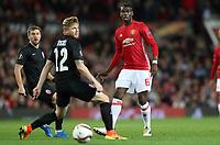 Football - 2016 / 2017 UEFA Europa League Manchester United v FC Zorya Luhansk at Old Trafford <br /> <br /> Paul Pogba of Manchester United and Rafael Forster of FC Zorya Luhansk<br /> <br /> COLORSPORT/LYNNE CAMERON