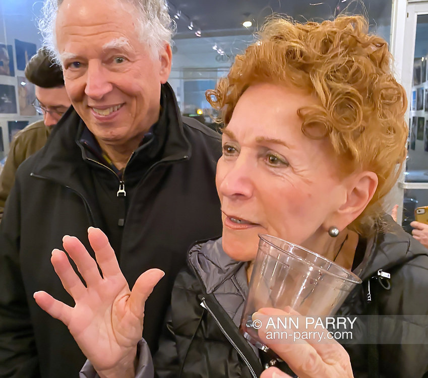 """Huntington, New York, U.S. February 29, 2020. Artist LINDA STALLONE LOUIS and her husband, of Dix Hills, are at fotofoto gallery reception for its """"Your Best Shot"""" Open Photography push-pin exhibition, which includes her photo of her young granddaughter."""