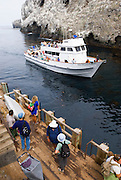 Visitors waiting to board the Island Packers boat at east Anacapa Island, Channel Islands National Park, California