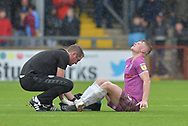 Rochdale midfielder Andy Cannon (27) is injured during the EFL Sky Bet League 1 match between Scunthorpe United and Rochdale at Glanford Park, Scunthorpe, England on 8 September 2018. Photo Ian Lyall