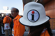 Volunteer tourist guides in Shinjuku, Tokyo, Japan. Friday December 9th 2016. In preparation for the 2020 Tokyo Olympics and to aid the increasing number of tourists visiting the country tourists guides organised by the Tokyo Government volunteer to provide multi-lingual information at popular destinations around the capital