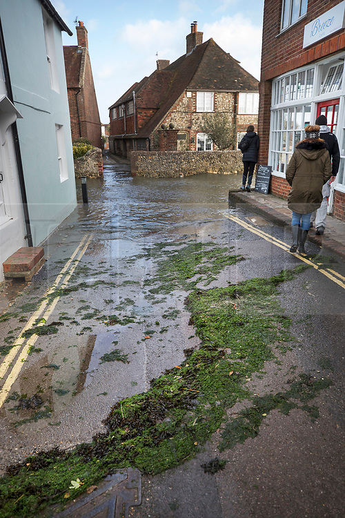 © Licensed to London News Pictures. 03/01/2018. Bosham, UK. Seaweed is seen in the High Street in Bosham after tidal flood water reached maximum height as storm Eleanor hit the south. Winds of up to 80 mph are being forecast today in parts of the UK. Photo credit: Peter Macdiarmid/LNP