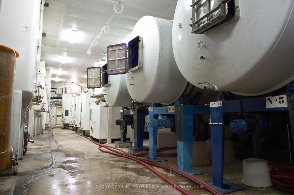 Steel fermentation tanks and rotating roto-fermenters, revolving fermentation tanks in the winery Domaine de Triennes Nans-les-Pins Var Cote d'Azur France