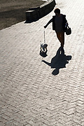 person walking her dog