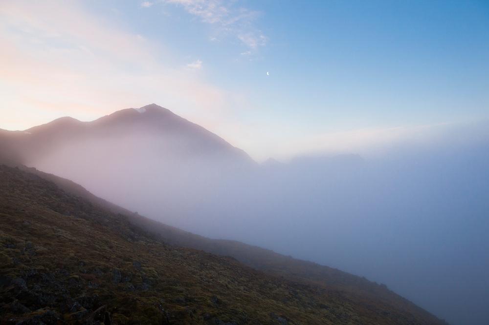 Low clouds obscure the summit of Fugleberget in Hornsund, Svalbard.