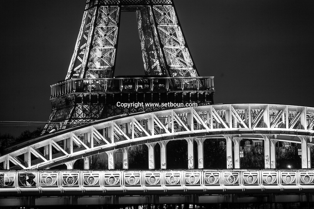 France.. Paris.  the Eiffel tower and RER bridge  on the seine river . Pont Rouelle (rail viaduct for line C of the RER crossing the Île aux Cygnes). Before to publish an image of the Eiffel tower lighting you should contact SETE; Mr Dieu at +33144112399 particularly for advertinsing.