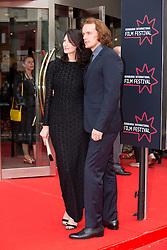 "Outlander stars Caitriona Balfe and Sam Heughan. Opening Night Gala and World Premiere of ""The Legend of Barney Thompson"", Edinburgh International Film Festival 17 - 28 June 2015."