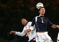 Photo: Andrew Unwin.<br />Scotland v USA. International Challenge. 12/11/2005.<br />Scotland's Andy Webster (R) beats the USA's Brian Ching (L) in the air.