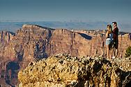 Tourists overlooking cliffs at Lipan Point, South Rim, Grand Canyon National Park, Arizona