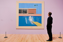 """© Licensed to London News Pictures. 06/02/2017. London, UK. A staff member views """"A Bigger Splash"""" at the preview of the world's most extensive retrospective of the work of David Hockney at the Tate Britain, which will be on display 9 February to 29 May 2017. Photo credit : Stephen Chung/LNP"""
