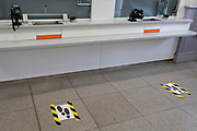 As the second week of the Coronavirus lockdown continues the UK death toll rises by 569 to 2,921, with 1m figure reported cases of Covid-19 being passed worldwide, hazard tape marks social distances on the floor of a deserted ticket hall of Herne Hill rail station in south London which is operating on reduced staffing hours, on 2nd April 2020, in London, England.