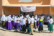 School children gather on a Saturday for the VSO ICS Community Action Day CAD in Y2K Hall Lindi, Lindi region. Tanzania.