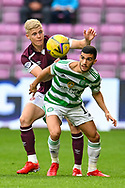 Liel Abada (#11) of Celtic FC shields the ball from Alex Cochrane (#17) of Heart of Midlothian FC during the Cinch SPFL Premiership match between Heart of Midlothian FC and Celtic FC at Tynecastle Park, Edinburgh, Scotland on 31 July 2021.