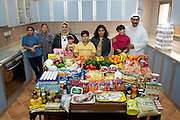 The Al Haggan family and their two Nepali servants in the kitchen of their home in Kuwait City, Kuwait, with one week's worth of food. From the book Hungry Planet: What the World Eats (Model Released)