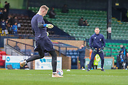 AFC Wimbledon goalkeeper Aaron Ramsdale (35) warming up with AFC Wimbledon goalkeeping coach Ashley Bayes in the baxkground during the EFL Sky Bet League 1 match between Southend United and AFC Wimbledon at Roots Hall, Southend, England on 16 March 2019.