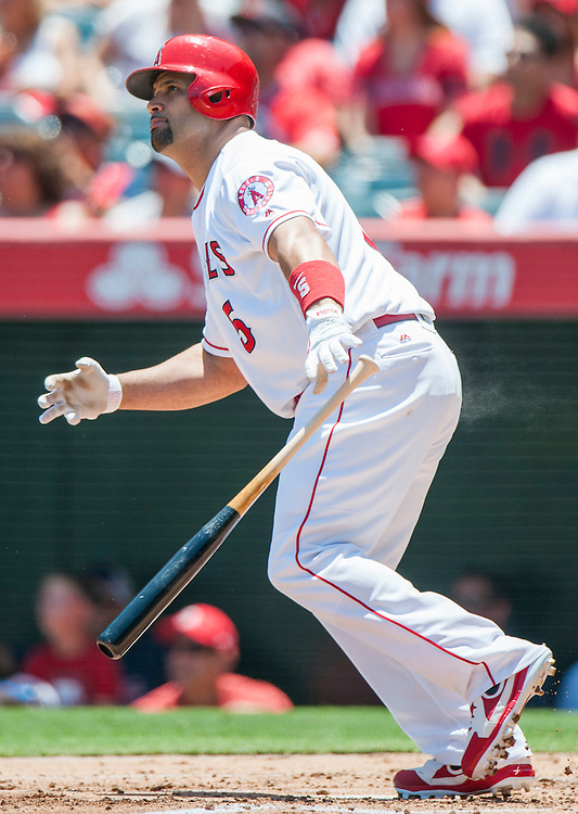The Angels' Albert Pujols watches his two-run home run in the first inning against the Chicago White Sox at Angel Stadium on Sunday.<br /> <br /> ///ADDITIONAL INFO:   <br /> <br /> angels.0718.kjs  ---  Photo by KEVIN SULLIVAN / Orange County Register  -- 7/17/16<br /> <br /> The Los Angeles Angels take on the Chicago White Sox at Angel Stadium.