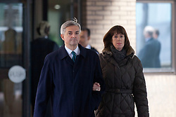 © Licensed to London News Pictures. 04/02/2013. London, UK. Former Cabinet minister Chris Huhne is seen leaving Southwark Crown Court with his partner Carina Trimingham in London after pleading guilty to conspiracy to pervert the course of justice and announcing his resignation as a member of parliament in conjunction with a 2003 speeding case. Photo credit: Matt Cetti-Roberts/LNP