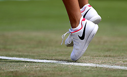 Detail of the trainers of Katie Boulter during her match against Christina McHale on day two of the Wimbledon Championships at The All England Lawn Tennis and Croquet Club, Wimbledon.  PRESS ASSOCIATION Photo. Picture date: Tuesday July 4, 2017. See PA story TENNIS Wimbledon. Photo credit should read: Steven Paston/PA Wire. RESTRICTIONS: Editorial use only. No commercial use without prior written consent of the AELTC. Still image use only - no moving images to emulate broadcast. No superimposing or removal of sponsor/ad logos.
