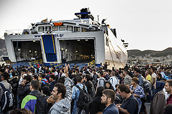 Oct. 8, 2015 - Lesbos Island, Greece - Migrants and refugees wait the departure for Athens in the port of Mytilene, Greek island of Lesbos after crossing the Aegean sea from Turkey on October 8, 2015..More than 400,000 refugees, mostly Syrians and Afghans, arrived in Greece since early January while dozens were drowned trying to make the crossing. In total 710,000 have entered the EU through Greece and Italy during the same period, according to the European Agency Frontex border surveillance. The migration issue has caused deep divisions within the European Union, which is trying to set the distribution of migrants among its member countries or limit the flow. (Credit Image: © Antonio Masiello/NurPhoto via ZUMA Press)