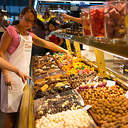 Seller at La Boqueria famous market, Barcelona, Spain