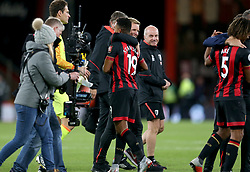 Bournemouth manager Eddie Howe hugs Bournemouth's Junior Stanislas at the end of the match