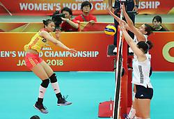 OSAKA, Oct. 10, 2018  Gong Xiangyu (L) of China spikes during the Pool F match against the United States at the 2018 Volleyball Women's World Championship in Osaka, Japan, Oct. 10, 2018. China won 3-0. (Credit Image: © Du Xiaoyi/Xinhua via ZUMA Wire)