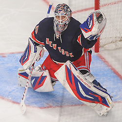 New York Rangers goalie Henrik Lundqvist (30) catches a shot during first period NHL action between the New York Islanders and the New York Rangers at Madison Square Garden in New York, N.Y.