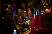 """Miles Devaney, 7, his brother Owen, 10, and mother Karen, of Washington State, look at artifacts at the """"Harry Potter"""" exhibition at Discovery Times in New York. ..Photo by Robert Caplin."""