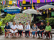 06 OCTOBER 2016 - BANGKOK, THAILAND: Community activists and supporters of the Pom Mahakan community talk to residents about their options in face of city plans to evict the residents. Evictions are continuing at a slow pace in Pom Mahakan Fort and as people move out their homes are destroyed to ensure new squatters don't move in. More than 40 families still live in the Pom Mahakan Fort community. Bangkok officials are trying to move them out of the fort and community leaders are barricading themselves in the fort. The residents of the historic fort are joined almost every day by community activists from around Bangkok who support their efforts to stay. City officials said recently that they expect to have the old fort cleared of residents and construction on the new park started by the end of 2016.      PHOTO BY JACK KURTZ